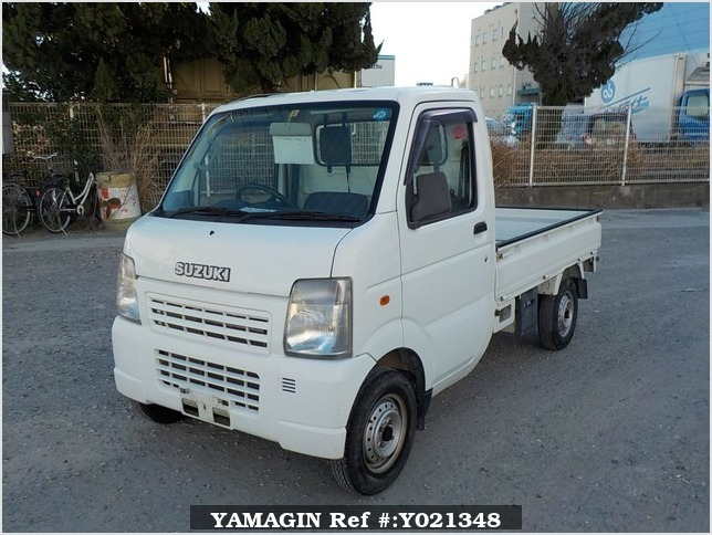 It is a picture of the white suzuki carry truck in 2006,Sub Photo 1 Stock No.Y021348