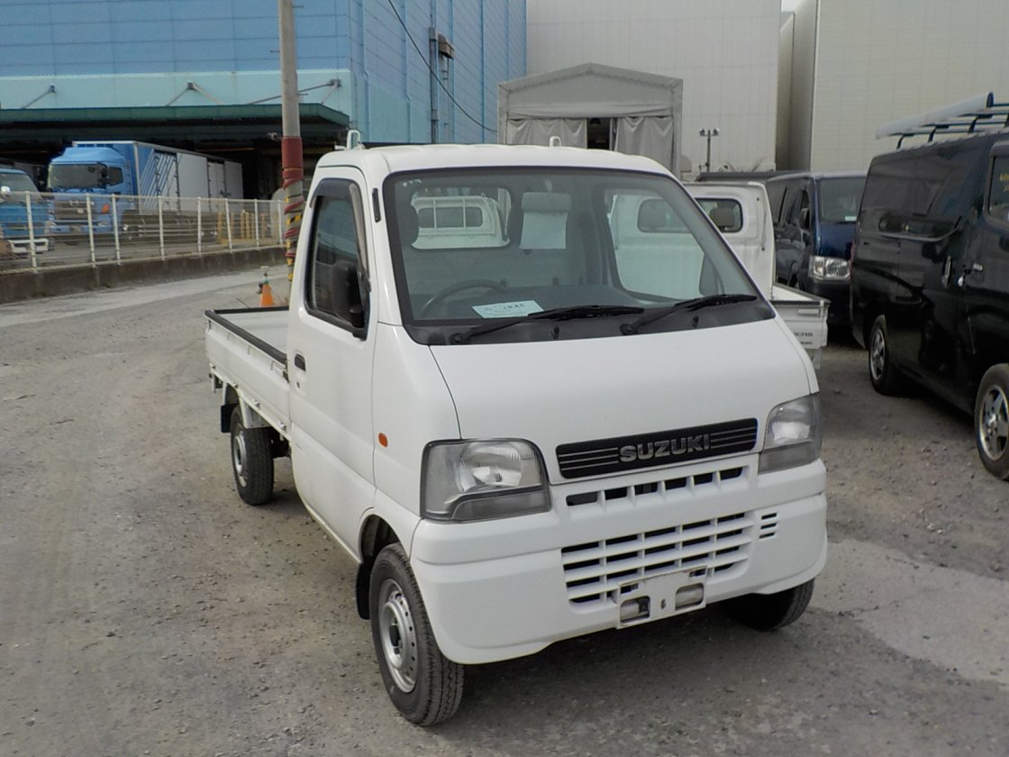 It is a picture of the white suzuki carry truck in 2001,First Photo Stock No.Y021505