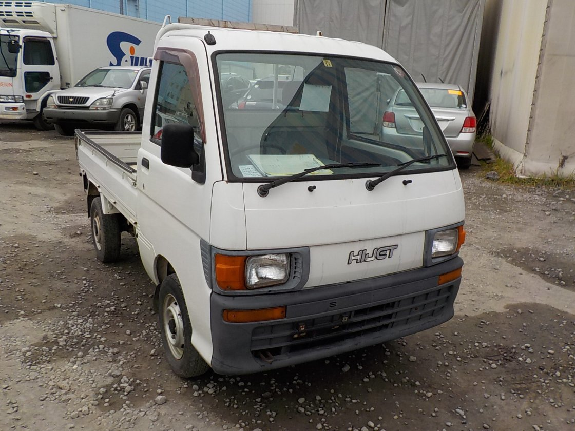 It is a picture of the white daihatsu hijet  truck in 1997,First Photo Stock No.Y021566