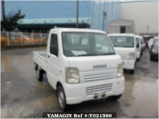 It is a picture of the white suzuki carry truck in 2005,Sub Photo 0 Stock No.Y021586