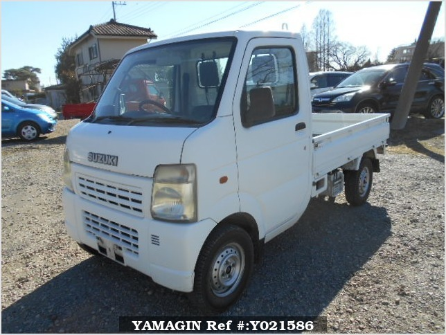 It is a picture of the white suzuki carry truck in 2005,Sub Photo 1 Stock No.Y021586