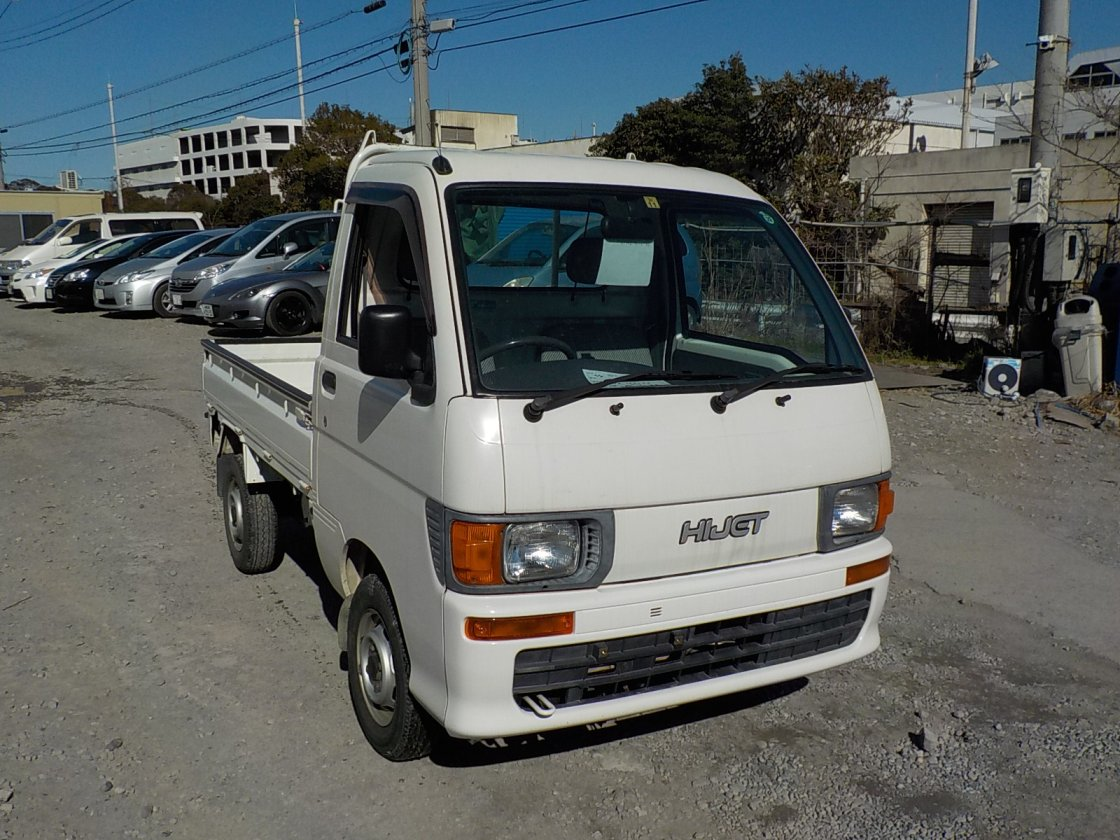 It is a picture of the white daihatsu hijet  truck in 1998,First Photo Stock No.Y021609
