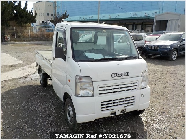 It is a picture of the white suzuki carry truck in 2003,Sub Photo 0 Stock No.Y021678