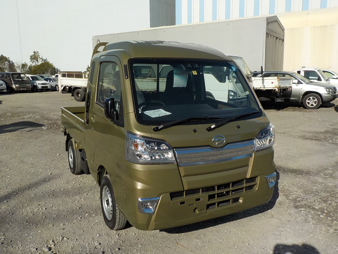 It is a picture of the khaki daihatsu hijet truck in 2018,First Photo Stock No.Y021799