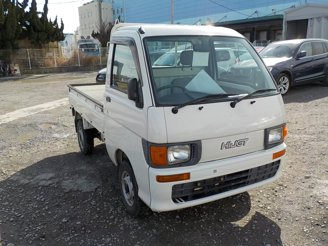 It is a picture of the white daihatsu hijet truck in 1998,First Photo Stock No.Y021801