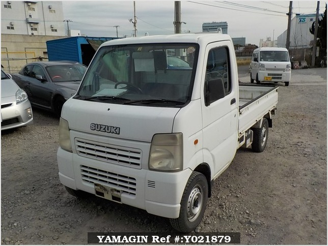 It is a picture of the white suzuki carry truck in 2003,Sub Photo 1 Stock No.Y021879