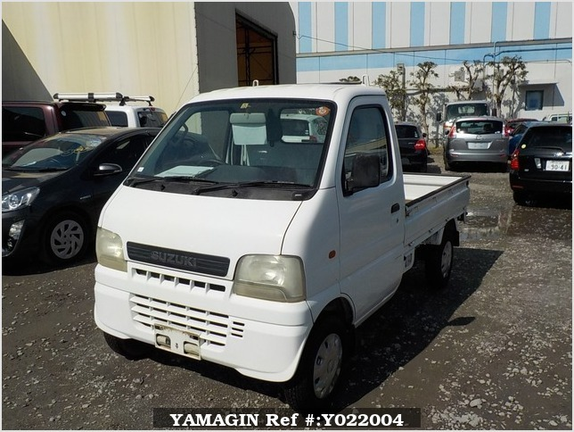 It is a picture of the white suzuki carry truck in 2001,Sub Photo 1 Stock No.Y022004