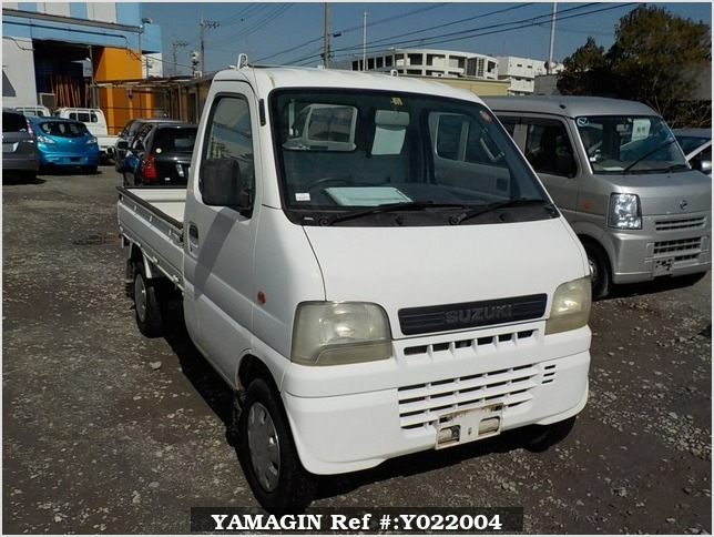 It is a picture of the white suzuki carry truck in 2001,Sub Photo 0 Stock No.Y022004