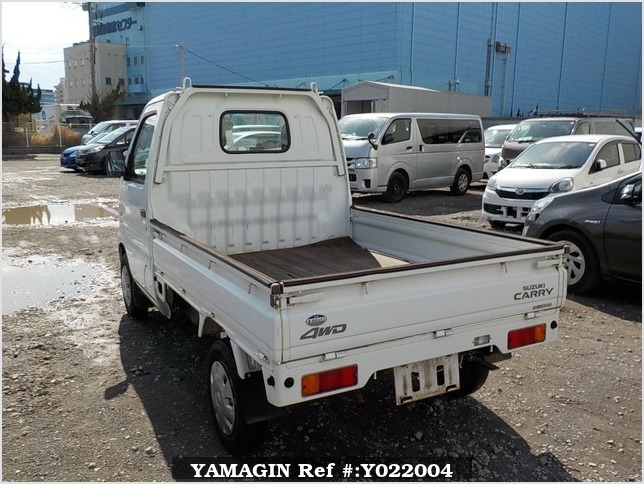 It is a picture of the white suzuki carry truck in 2001,Sub Photo 3 Stock No.Y022004
