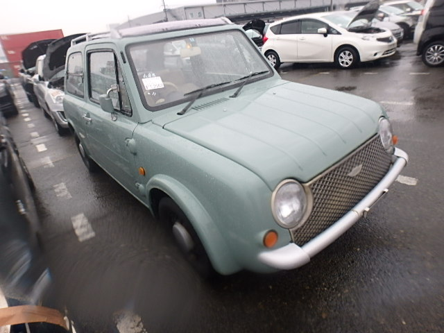 It is a picture of the olive nissan pao open top in 1989,First Photo Stock No.Y022101