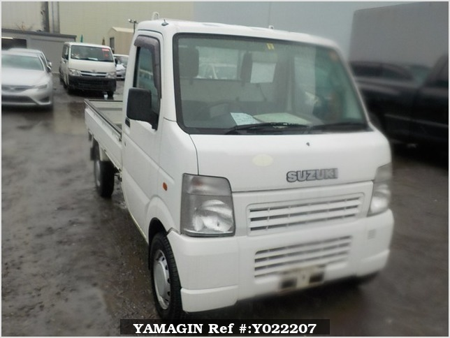 It is a picture of the white suzuki carry truck in 2005,Sub Photo 0 Stock No.Y022207