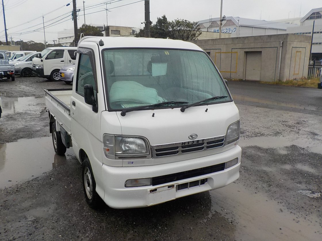 It is a picture of the white daihatsu hijet truck in 1999,First Photo Stock No.Y022315