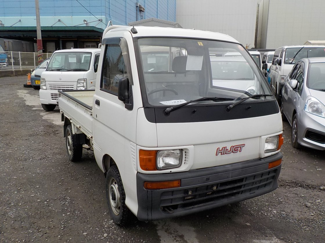 It is a picture of the white daihatsu hijet truck in 1995,First Photo Stock No.Y022368