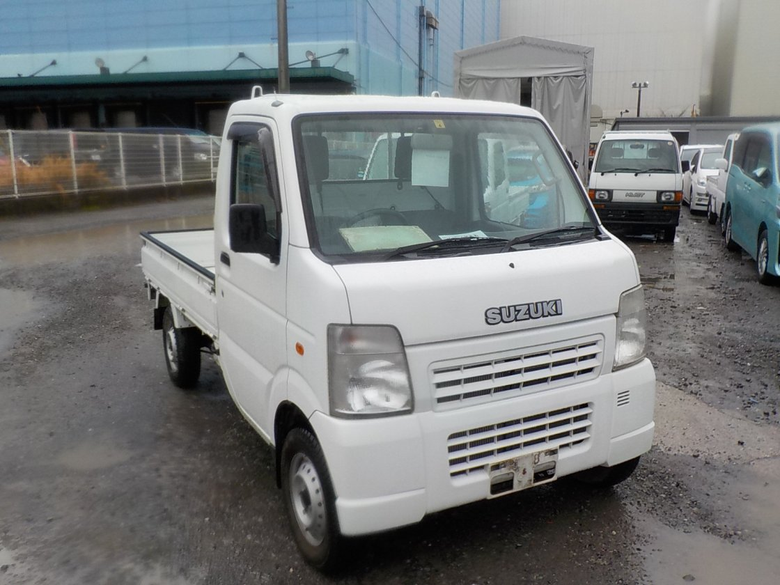 It is a picture of the white suzuki carry truck in 2009,First Photo Stock No.Y022387