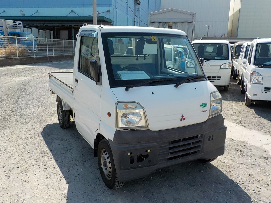 It is a picture of the white mitsubishi minicab  truck in 1999,First Photo Stock No.Y022532