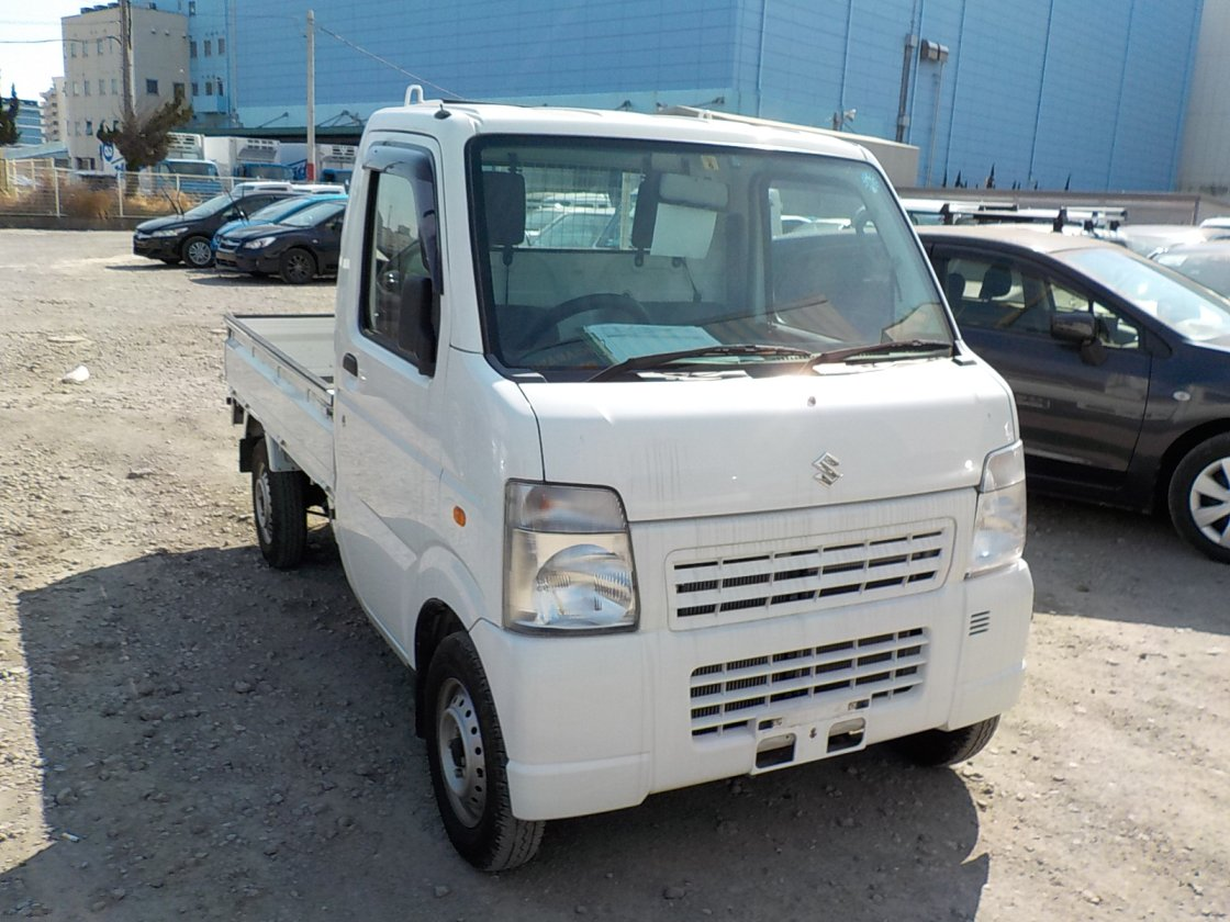 It is a picture of the white suzuki carry  truck in 2010,First Photo Stock No.Y022581