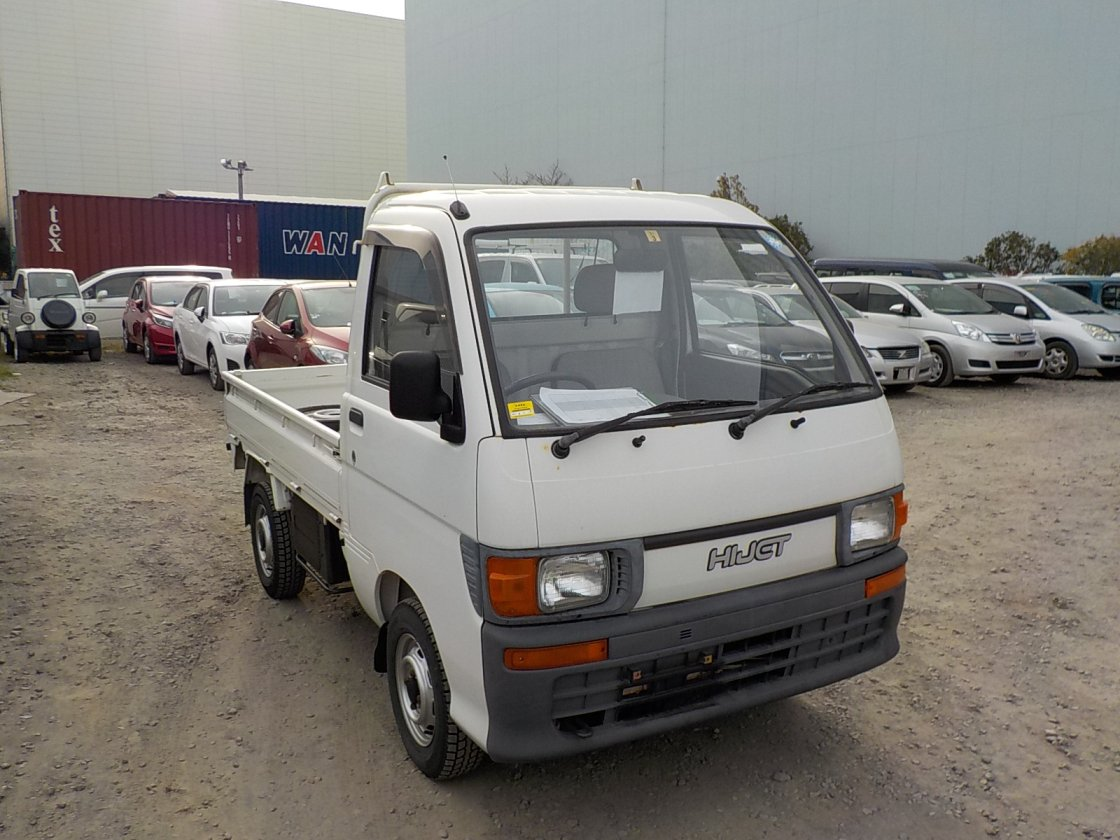 It is a picture of the white daihatsu hijet truck in 1995,First Photo Stock No.Y022686