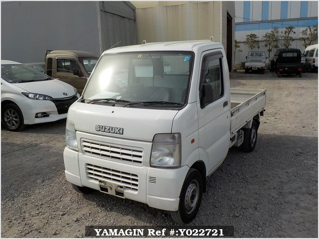 It is a picture of the white suzuki carry truck in 2004,Sub Photo 1 Stock No.Y022721