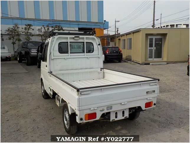 It is a picture of the white suzuki carry truck in 2003,Sub Photo 3 Stock No.Y022777