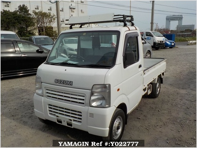 It is a picture of the white suzuki carry truck in 2003,Sub Photo 1 Stock No.Y022777