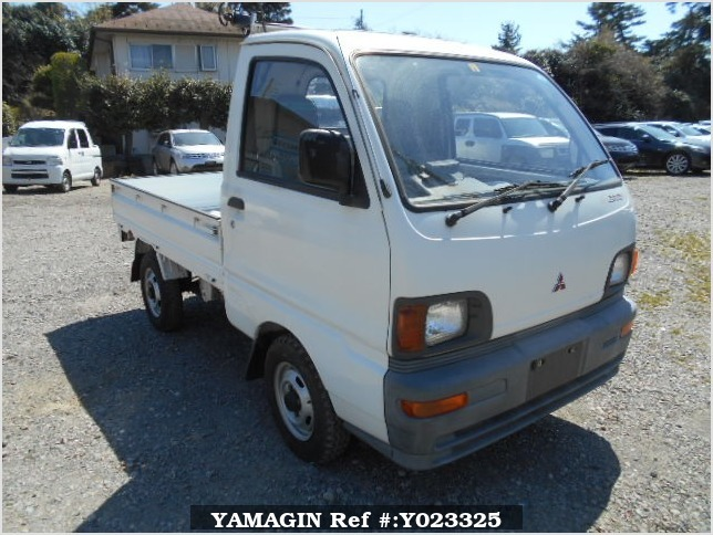 It is a picture of the white mitsubishi minicab truck in 1994,Sub Photo 0 Stock No.Y023325