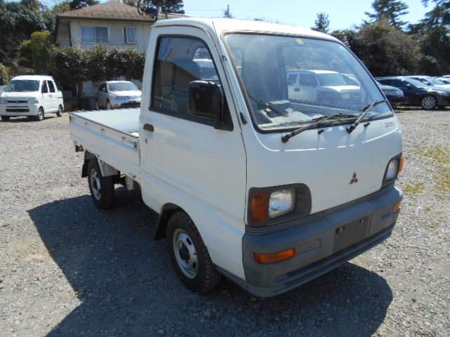 It is a picture of the white mitsubishi minicab truck in 1994,First Photo Stock No.Y023325