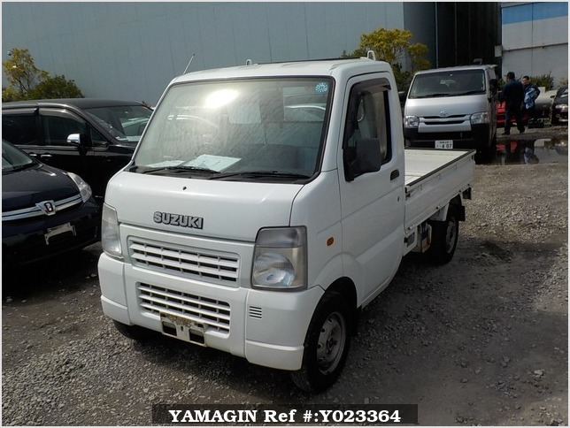 It is a picture of the white suzuki carry truck in 2003,Sub Photo 1 Stock No.Y023364