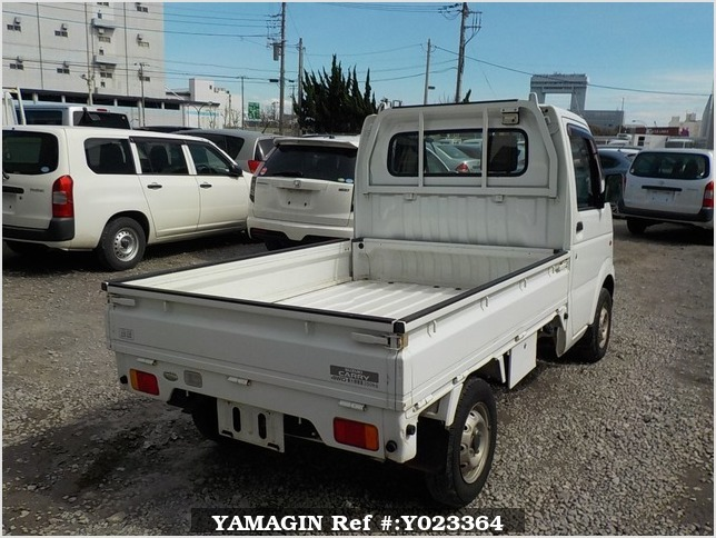 It is a picture of the white suzuki carry truck in 2003,Sub Photo 2 Stock No.Y023364