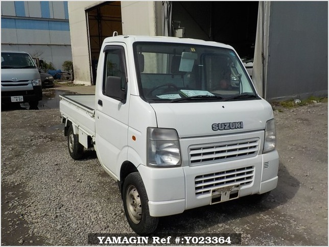 It is a picture of the white suzuki carry truck in 2003,Sub Photo 0 Stock No.Y023364