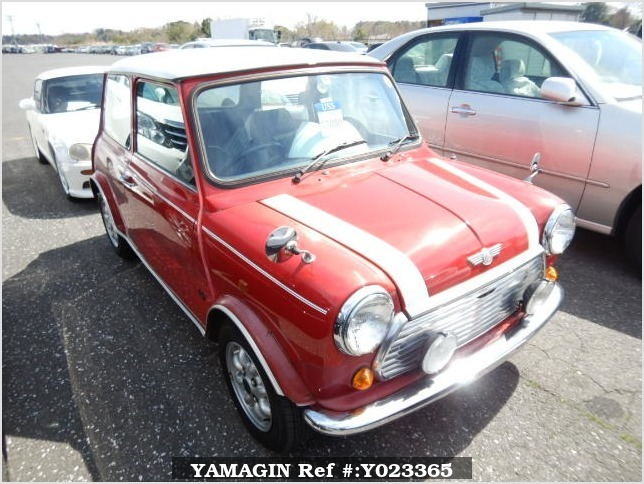 It is a picture of the red 2 rover mini in 1992,Sub Photo 0 Stock No.Y023365