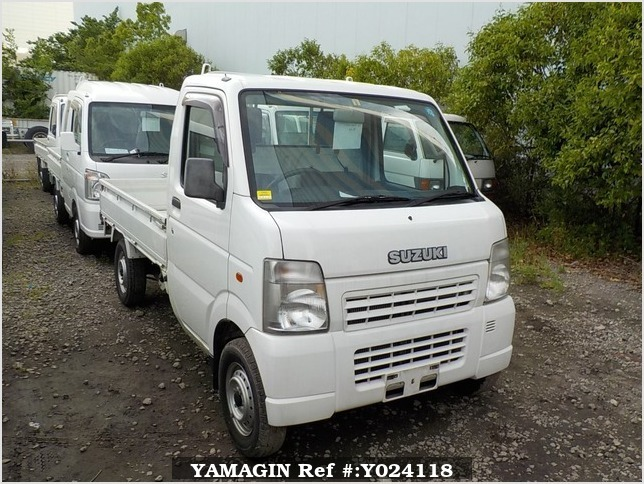 It is a picture of the white suzuki carry truck in 2003,Sub Photo 0 Stock No.Y024118