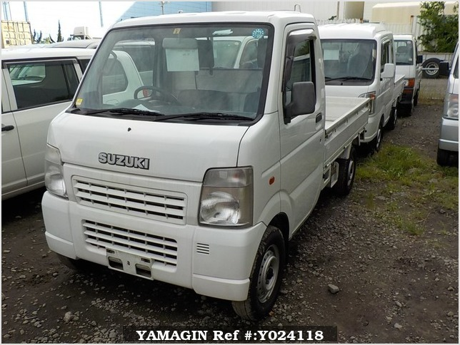 It is a picture of the white suzuki carry truck in 2003,Sub Photo 1 Stock No.Y024118