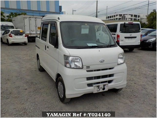 It is a picture of the white daihatsu hijet deck van in 2009,Sub Photo 0 Stock No.Y024140
