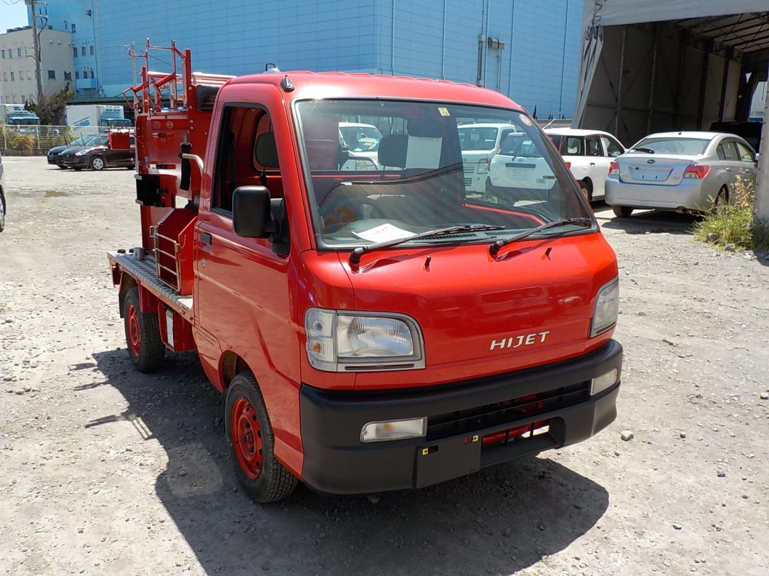 It is a picture of the red daihatsu hijet fire truck in 1999,First Photo Stock No.Y024206