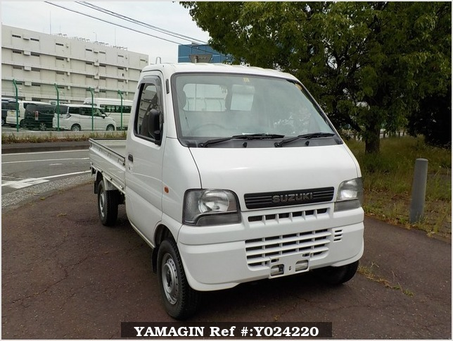 It is a picture of the white suzuki carry truck in 2001,Sub Photo 0 Stock No.Y024220