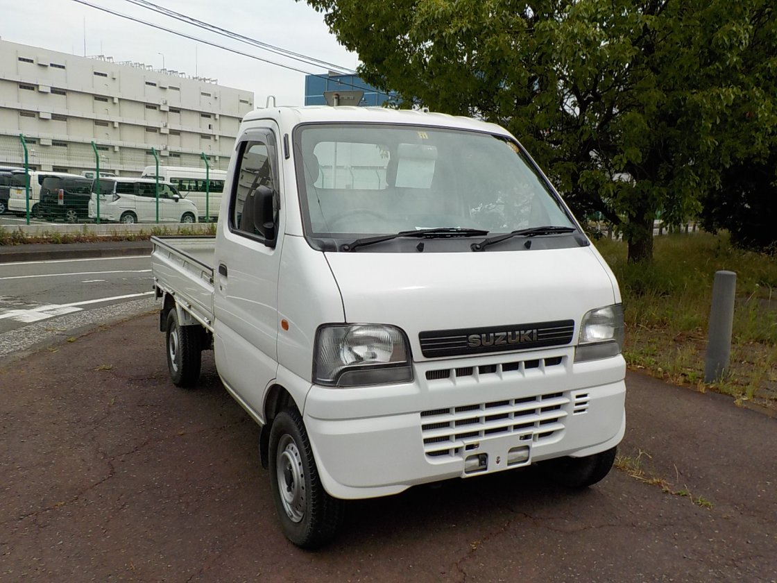 It is a picture of the white suzuki carry truck in 2001,First Photo Stock No.Y024220