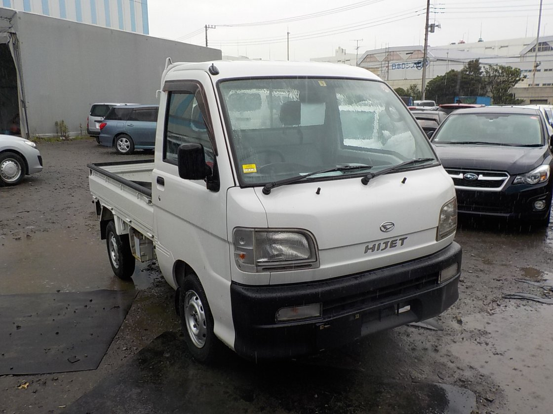 It is a picture of the white daihatsu hijet truck in 1999,First Photo Stock No.Y025101