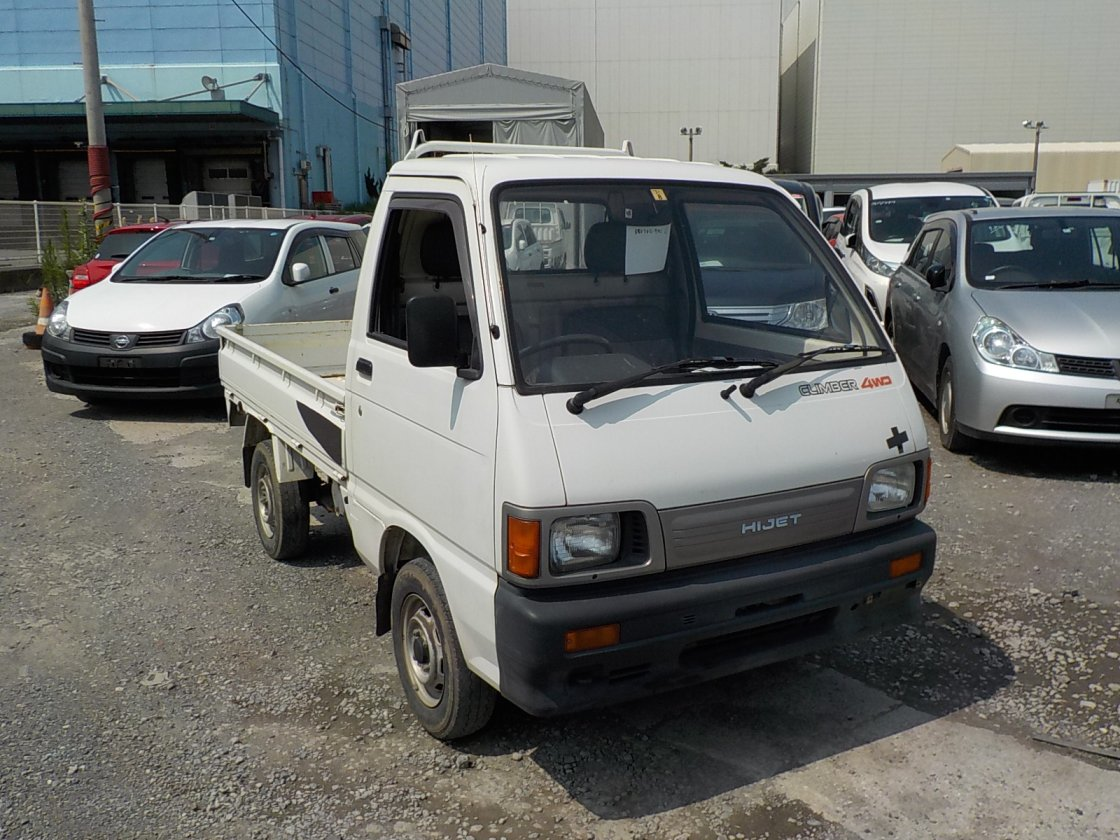 It is a picture of the white daihatsu hijet truck truck in 1993,First Photo Stock No.Y025602