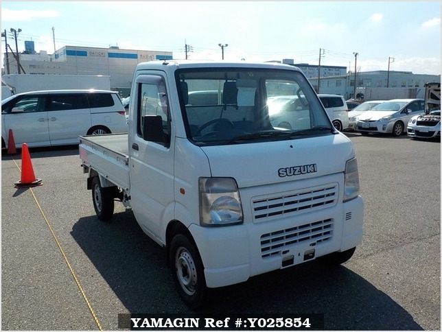 It is a picture of the white suzuki carry truck in 2005,Sub Photo 0 Stock No.Y025854