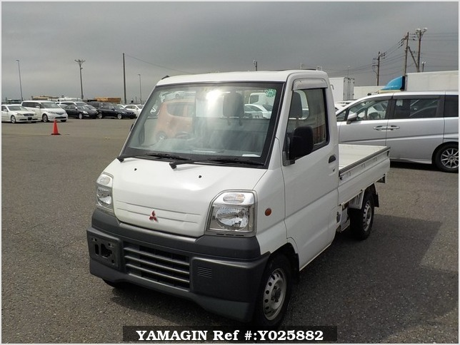 It is a picture of the white mitsubishi minicab truck in 1999,Sub Photo 1 Stock No.Y025882