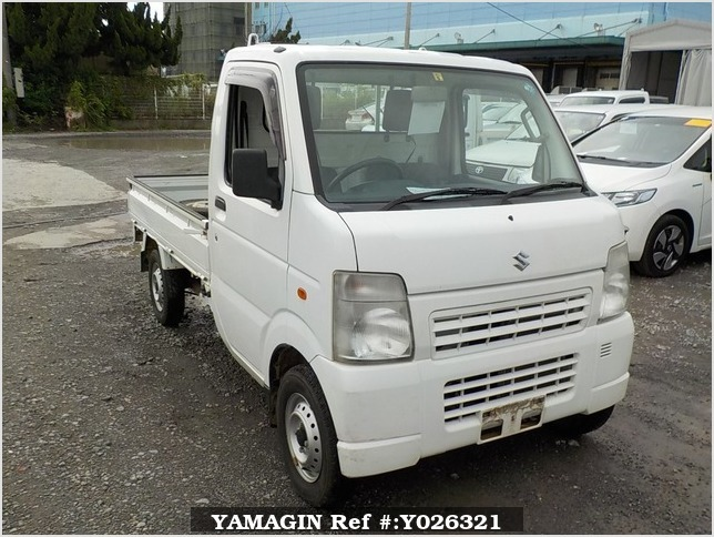 It is a picture of the white suzuki carry truck in 2009,Sub Photo 0 Stock No.Y026321