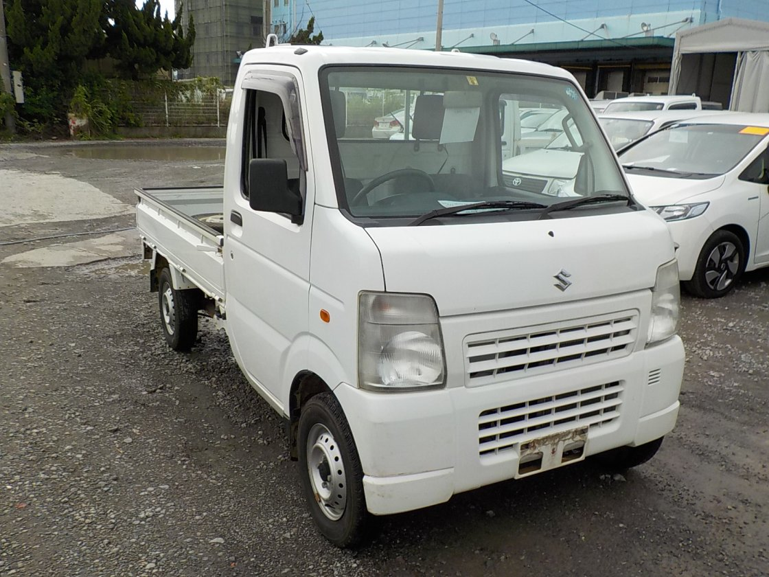 It is a picture of the white suzuki carry truck in 2009,First Photo Stock No.Y026321