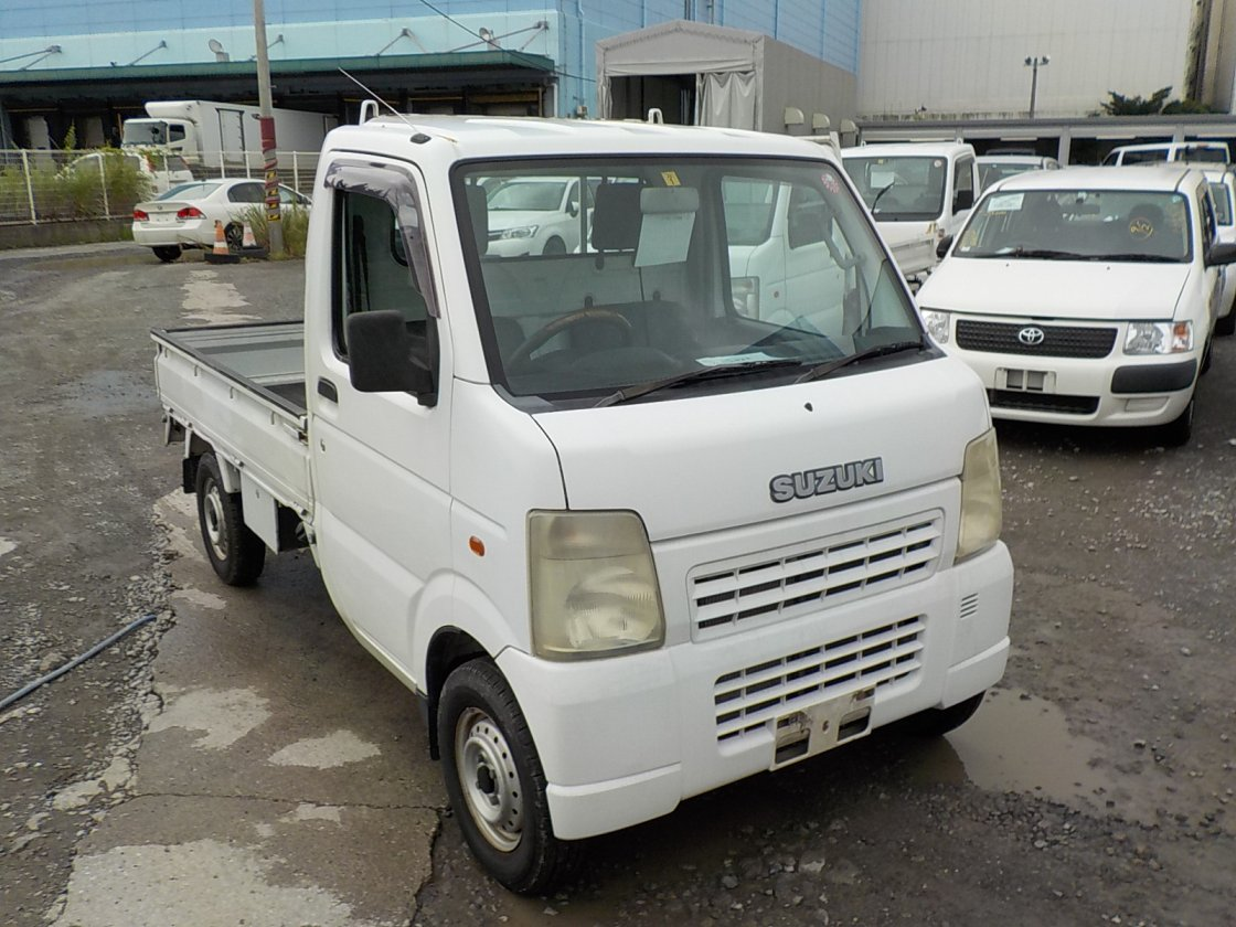 It is a picture of the white suzuki carry  truck in 2003,First Photo Stock No.Y026323