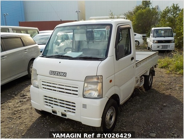 It is a picture of the white suzuki carry truck in 2003,Sub Photo 1 Stock No.Y026429