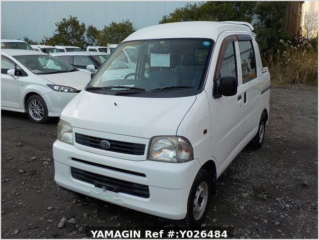 It is a picture of the white daihatsu hijet  deck van in 2004,Sub Photo 1 Stock No.Y026484