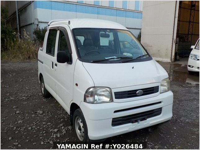 It is a picture of the white daihatsu hijet  deck van in 2004,Sub Photo 0 Stock No.Y026484
