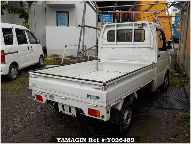 It is a picture of the white suzuki carry truck in 2003,Sub Photo 2 Stock No.Y026489
