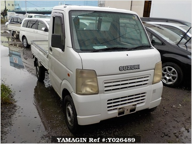It is a picture of the white suzuki carry truck in 2003,Sub Photo 0 Stock No.Y026489