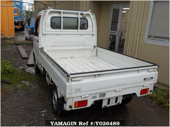It is a picture of the white suzuki carry truck in 2003,Sub Photo 3 Stock No.Y026489