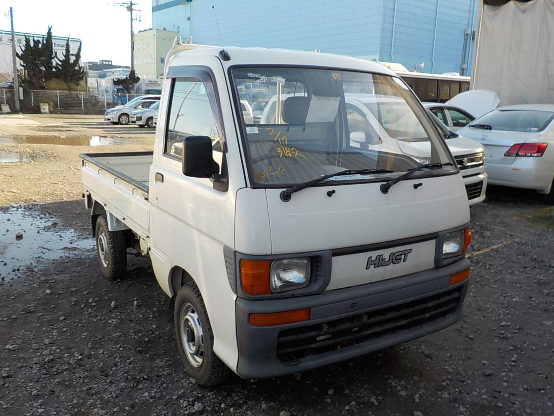 It is a picture of the white daihatsu hijet truck in 1995,First Photo Stock No.Y027288